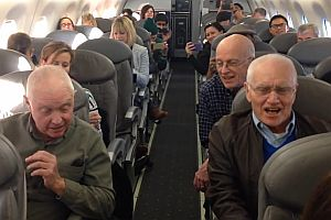 Spontaner Gesang im Flugzeug