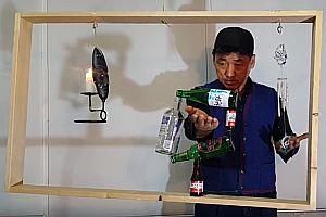 RockyByun balanciert Flaschen